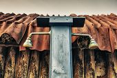 stock photo of beach hut  - Rusty vintage beach shower attached to wooden hut - JPG
