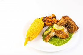 foto of sweet-corn  - Grouper fillets fried golden brown and served on parsley and garlic pesto sauce with corn on the cob and roasted sweet potatoes - JPG