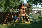 stock photo of swingset  - backyard wooden playground set for a child - JPG