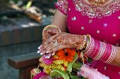 foto of henna tattoo  - Hands of a Indian bride with henna design and bangles