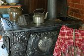 Antique Stove In A Old-Fashioned Kitchen