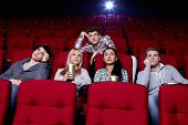 image of watching movie  - Satisfied girls and bored boys watching a movie at the cinema - JPG
