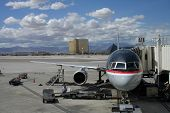 stock photo of las vegas casino  - A jetliner at the airport terminal waits for passengers and baggage - JPG