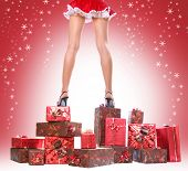 sexy young Santa-girl with gift boxes