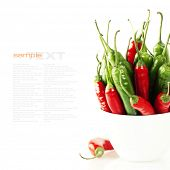 Peppers in plate on white background (with space for text)