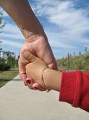 picture of holding hands  - Mom and his young son holding hands - JPG