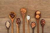 Different Kind Of Beans And Lentils In Wooden Spoon On Wood Background. Mung Bean, Groundnut, Walnut poster