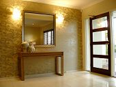 foto of console-mirror  - Beautifully decorated entry hall way with feature console table - JPG