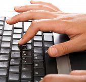 Woman?s hands working on the laptop