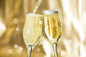 foto of congrats  - Pair of champagne flutes making a toast - JPG