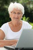 Elderly woman using internet