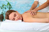 Closeup of beautiful blond woman on a massage bed