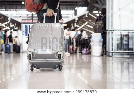 poster of Traveling Luggage Walking At Airport Terminal For Checkin. Travel And Vacation Concept