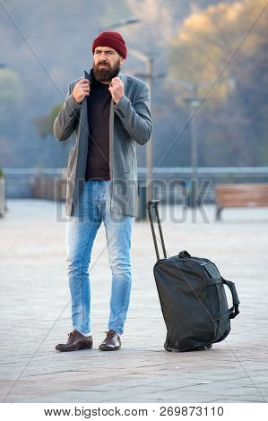 poster of Looking For Accommodation. Man Bearded Hipster Travel With Big Luggage Bag Wait For Taxi Bring Him T