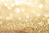 Golden Sparkle Glitters With Bokeh Effect And Selectieve Focus. Festive Background With Bright Gold  poster