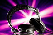 headphones against purple rays background
