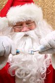Santa Claus. Santa shows you how to Brush Your Teeth. Santa wants you to brush your teeth for Christ poster