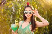 Beach Woman Drinking Cold Drink Beverage Having Fun At Resort Outside. Portrait Of Beautiful Young A poster
