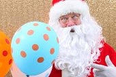 Santa Claus. Santa Claus holds Balloons. Merry Christmas Balloons. Helium Balloon. Gold Sequin Backg poster