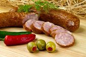 Polish kielbasa with olives and chilli peppers