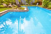 Pool In Tropical Hotel Or Residential House. Nice Swimming Pool In Courtyard In Summer. Idyllic Plac poster