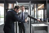 Security Man Check Businessman At Entrance In Office Building Or Airport poster