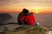 stock photo of cliffs moher  - Loving Couple at sunset on irish Cliffs of Moher - JPG