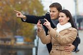 Couple Taking Pictures With Mobile Phone