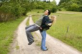 Mixed couple exercising outdoor