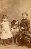 Vintage photo of children with a dog (circa 1893)