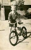 Vintage photo of boy with bicycle (early fifties)