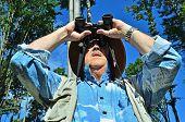 Senior birdwatcher in forest