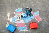 Little Kid Boy Having Fun With With Airplane Picture Drawing With Colorful Chalks On Asphalt. Child  poster