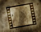 Film frame on a grunge parchment
