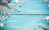 White Christmas Fir Tree Branches White Snowflakes And Stars On Vintage Blue Wooden Rustic Backgroun poster