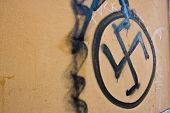 stock photo of swastika  - Swastika painted on a wall - JPG