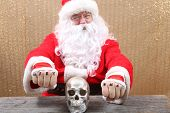 Santa Claus. Santa shows his knuckle tattoos which read Mery Xmas. Santa is one tough MFer! Dont m poster