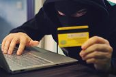 Man In Robber Mask Uses Internet, Bank Account And Credit Facilities. Phishing Attack By Male With H poster