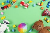 Baby Kids Toys Frame With Teddy Bear, Toy Cars, Robot, Colorful Bricks, Cubes On Pink Background poster
