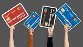 Hand holding credit card clipart poster