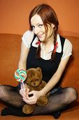 Red head girl and teddy bear