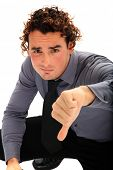young business man thumb down isolated on white