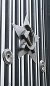 stock photo of hammer sickle  - Metal emblem on the gate  - JPG