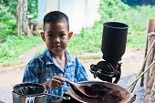 foto of wooden box from coffee mill  - little boy with Vintage coffee mill grinder - JPG