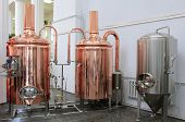 stock photo of brew  - Copper tuns for brewing at a brewery - JPG