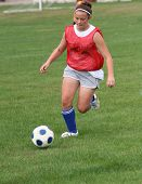 Youth Teen Soccer Player Running After Ball