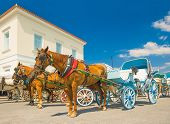 Traditional Horse Drawn Taxis On The Island Of Spetses, Greece