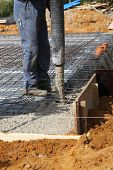 Builder Pouring Concrete Foundations