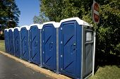 stock photo of porta-potties  - All in a row portable toilets ready to use - JPG