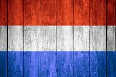 stock photo of holland flag  - Holland flag or white or red white and blue Dutch banner on wooden background - JPG